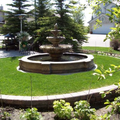After Garden Fountain Landscape Design Before After by European Garden Design Calgary
