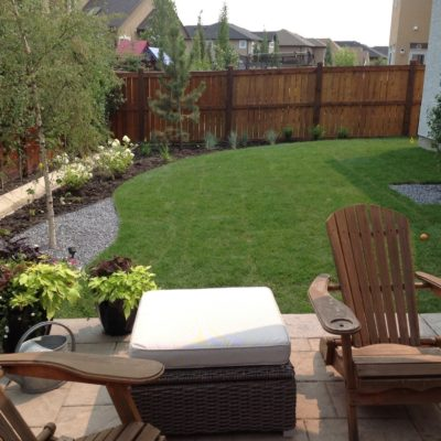 Backyard Seating Area and Lawn Landscape by European Garden Design Calgary