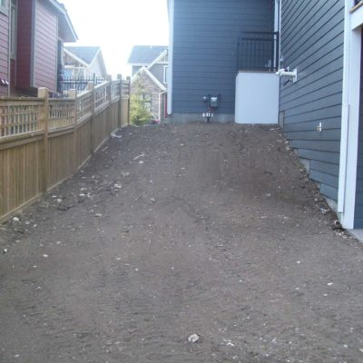 Before Backyard Transformation Garden with Wooden Stairs and Natural Stone Flower Border Before After by European Garden Design Calgary