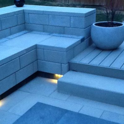 Comtemporary Stone Patio Seating and Raised Deck at Dusk Contemporary by European Garden Design Calgary
