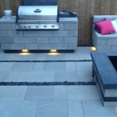 Comtemporary Stone Patio with BBQ area Dusk Contemporary by European Garden Design Calgary