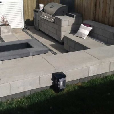 Comtemporary Stone Patio with BBQ area in Daytime Contemporary by European Garden Design Calgary