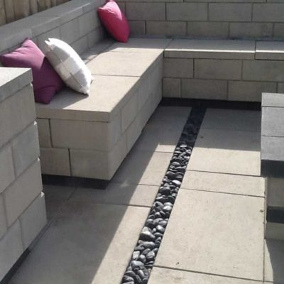 Comtemporary Stone Patio with Fireplace and Seating in Daytime Contemporary European Garden Design Calgary