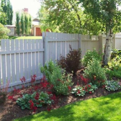 Decorative White Fence and Flower Garden Landscape Design Flower Gardens by European Garden Design Calgary