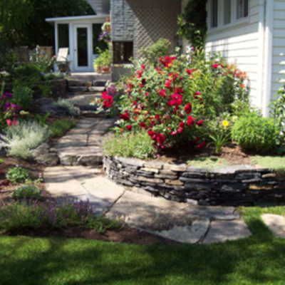 Flower Garden with Stonework by European Garden Design Calgary