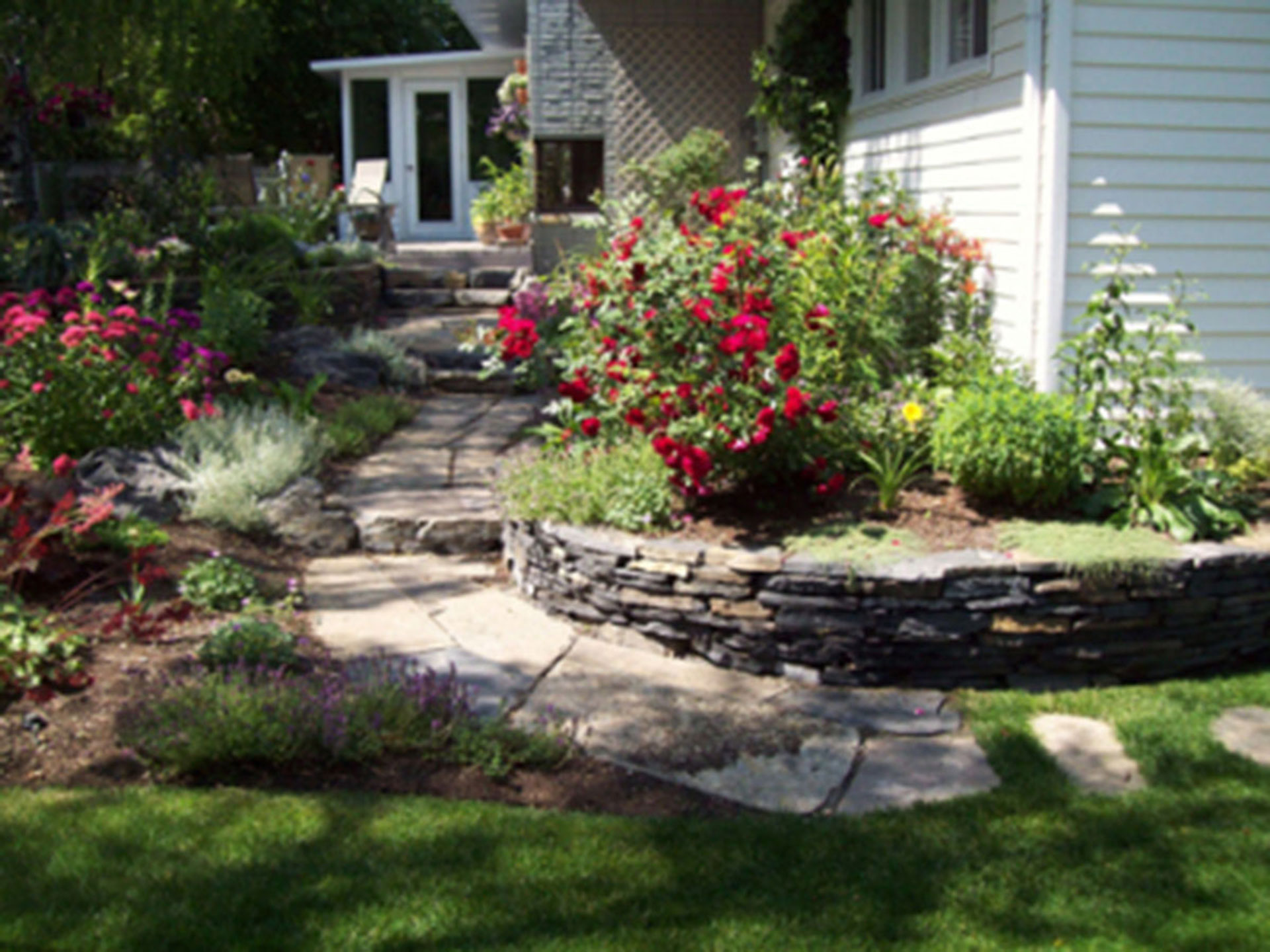 Flower Garden With Stonework European Garden Design Calgary