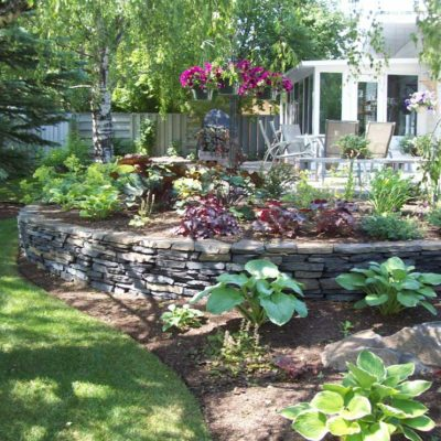 Flowering Garden with Natural Stone Landscape Design Flower Gardens by European Garden Design Calgary