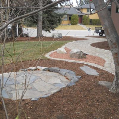 Seating Area and Natural Stone Pathway in Stonework by European Garden Design Calgary