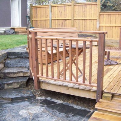 Stonework Fencing and Deck with Railing in Decks and Fences by European Garden Design Calgary
