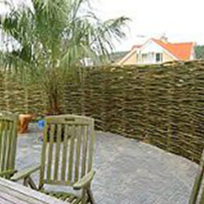 Wattle Fence Privacy Screen for Backyard Seating Area in Decks and Fences by European Garden Design Calgary