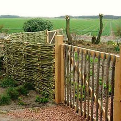 Wattle Fence and Custom Wooden Garden Gate in Decks and Fences by European Garden Design Calgary