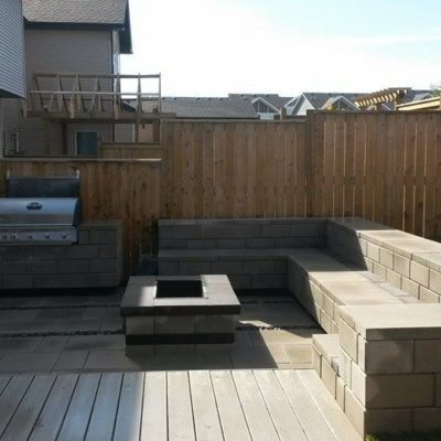 Comtemporary Stone Patio with Fireplace Seating and Barbeque Area in Daytime Contemporary by European Garden Design Calgary