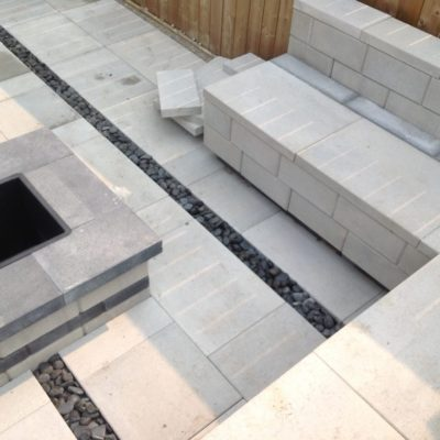 Comtemporary Stone Patio with Fireplace and Seating Stonework by European Garden Design Calgary