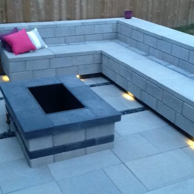 Comtemporary Stone Patio with Fireplace and Seating at Dusk Contemporary by European Garden Design Calgary