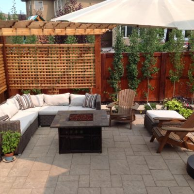 Modern Patio with Outdoor Seating and Fireplace by European Garden Design Calgary_o