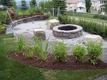 Natural Stone Backyard Firepit Stonework by European Garden Design Calgary