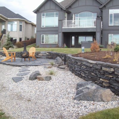 Natural Stone Seating Area by European Garden Design Calgary