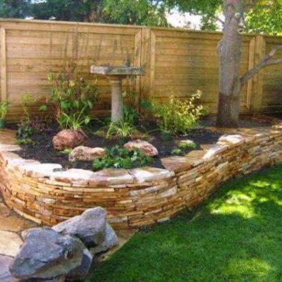 Natural Stonework Garden Border by European Garden Design Calgary