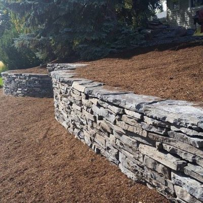 Stone Work Retaining Wall from the Side by European Garden Design Calgary