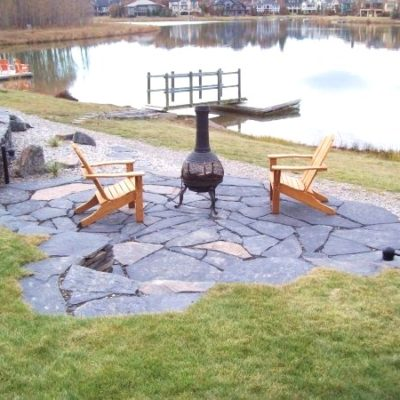 Stonework Patio Seating Area by European Garden Design Calgary